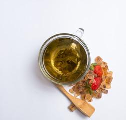 mug of green tea with strawberries