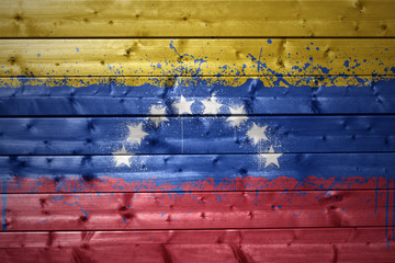 painted venezuelan flag on a wooden texture