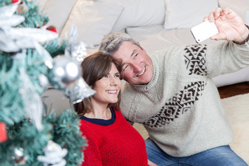 Couple taking a photo in christmas