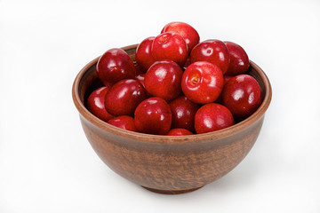 cherries in bowl isolated