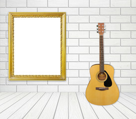 Guitar and picture frame in room