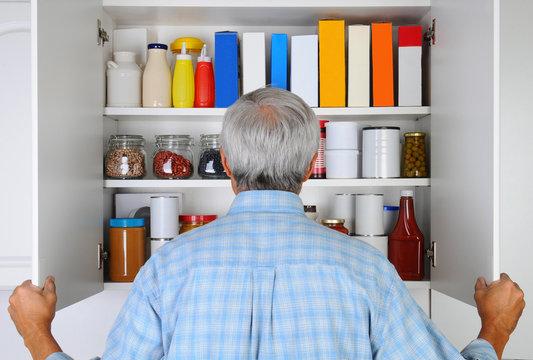 Man Looking in His Pantry