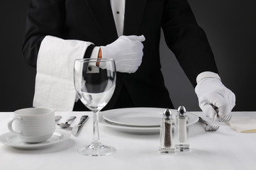 Waiter Setting Formal Dinner Table
