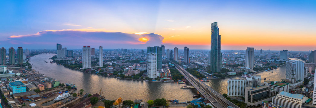 Landscape of river in Bangkok cityscape with sunset