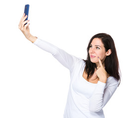 Brunette woman take selfie by smartphone
