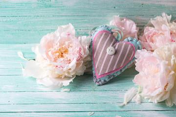 Decorative heart and splendid peonies flowers