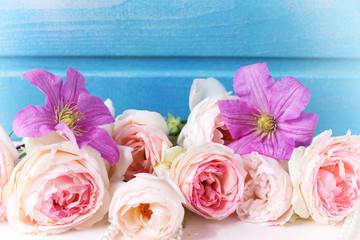 Pastel pink roses, clematis flowers