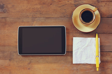 top view image of tablet device, coffee and paper note