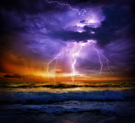 Keuken foto achterwand Onweer lightning and storm on sea to the sunset - bad weather