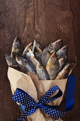 Bouquet from salty dry fish with a blue bow. Gift for men.