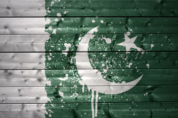 painted pakistani flag on a wooden texture