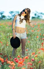 Beautiful girl in a summer field