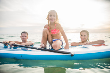 Family with paddle board