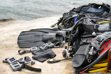 Pile of Scuba Diving Equipment Drying on Dock Wall mural