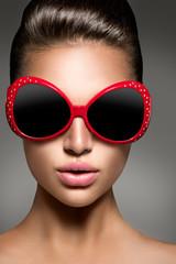 Beauty fashion model brunette girl wearing stylish sunglasses
