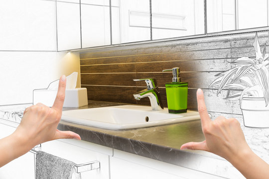 Female hands framing custom bathroom design.
