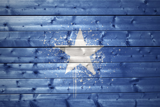 painted somalia flag on a wooden texture