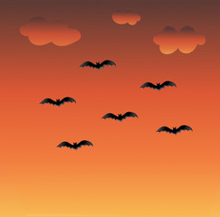 Sunset colors background with clouds and flying bats