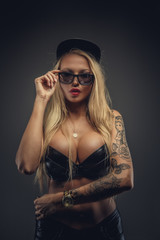 Portrait of sexy blond girl with tattoos.