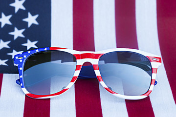 Patriotic holiday 4th of july: glasses  over American flag