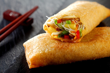 Crispy spring roll with vegetables and sprouts