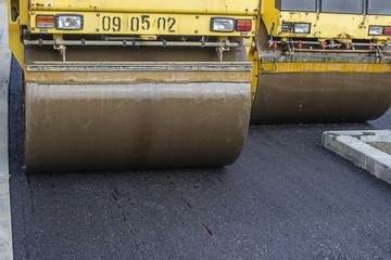 Close of two road roller compacting asphalt
