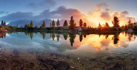 Mountain alps lake sunset panorama in Dolomites