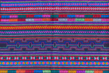 Colorful Thailand style rug surface close up vintage fabric is m