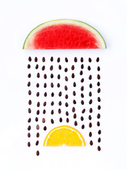 weather concept, watermelon and orange shape of rainy season. pa