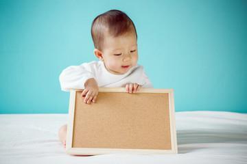 Baby with Blank Board, studio shot