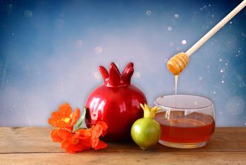 rosh hashanah (jewesh holiday) concept - honey pomegranate