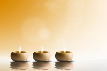 Zen concept. Candles on orange background.
