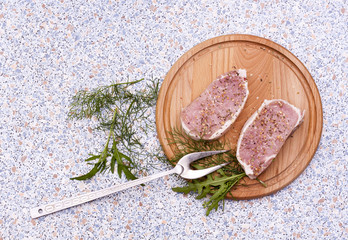 Fresh Raw Steak Meat with spaces, herbs and vegetables