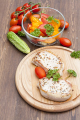 Fried pork steak with vegetables and parsley on a wooden board