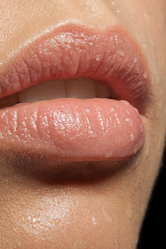 close-up of lips with drops of water