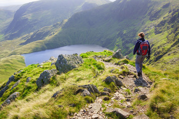 A lone hiker walking in the Lake District
