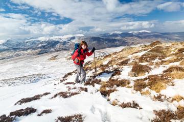 Female hiker on a winter mountain walk.