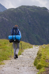 A woman hiker backpacking in the Lake District.