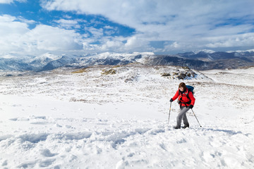 Female hiker on a winter mountain walk.