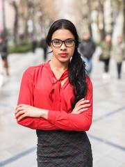 Hispanic stewardess in urban background