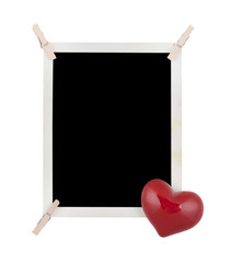 Photo frame with clothespins and heart