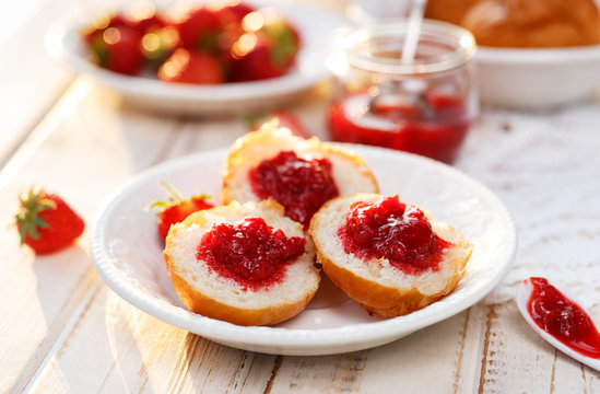 Homemade strawberry jam on a buttery scones