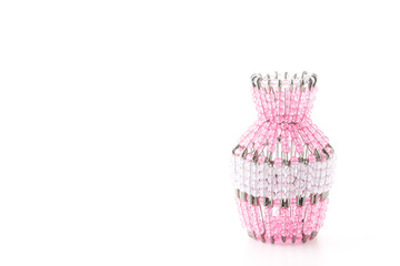 Bead woven vase isolated on white background