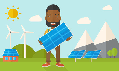 African man holding a solar panel.