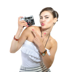 Beautiful girl takes her self picture with retro photo camera, o