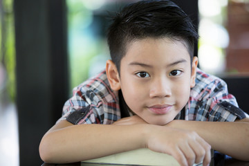 Asian boy is little smile and looking camera