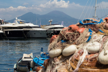 The view on the mount and volcano Vesuvius behind some fishing net