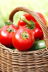 fresh tomatoes in a wicker basket
