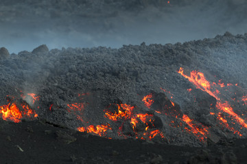 Lava flow at dawn. Eruption of Etna volcano's May 16, 2015