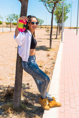 Young woman posing with her skateboard